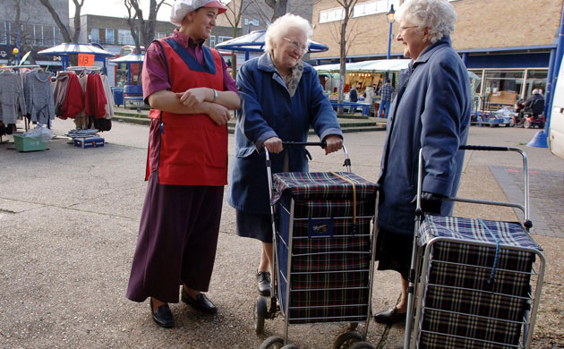 Elderly ladies with tartan shopping trolleys