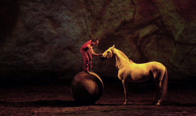 A rider performs with a horse during an equestrian show called  Cavalia