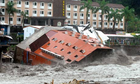 Seven-story hotel falls into the unprecedented river floods caused by the deadly Typhoon Morakot devastating Taiwan.