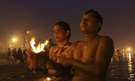 Hindu devotees offer prayers during the Makar Sankranti festival in Allahabad, India