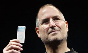 Apple CEO Steve Jobs holds up the new iPod nano