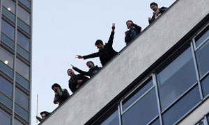 Students on the roof of the Conservative headquarters