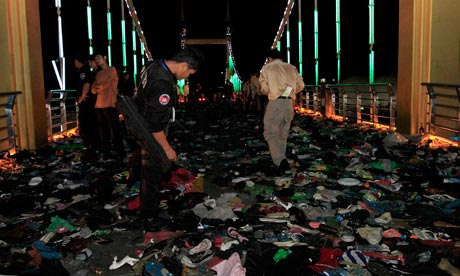 Cambodian military police examine the bridge where a stampede took place