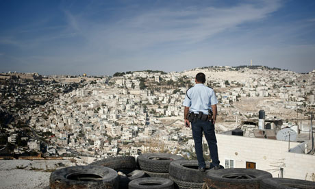 An Israeli policeman stands guard on the