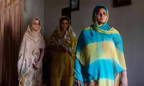 Hina Muhammad, right, and her sisters mourn the death of their father and two brothers in Karachi.