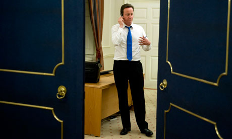 David Cameron on the phone at 10 Downing Street, taken by his official photographer.