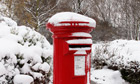 snow-covered royal mail post box