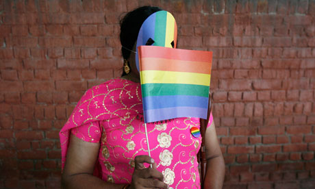 A gay rights activist displays a rainbow flag during