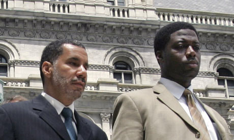 New York governor David Paterson, left, with aide David Johnson