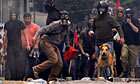 Demonstrators throw stones to the police in central Athens