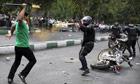 Iranian riot-police officer sprays tear-gas