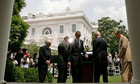 President Barack Obama leaves the podium in the Rose Garden of the White House