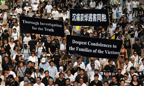 Hong Kong locals take to the streets to show their anger after the Manila bus hostage crisis