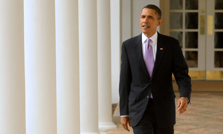 Barack Obama walks down the colonnade of the White House