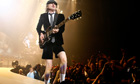 AC/DC lead guitarist Angus Young performs in London