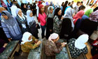 Tunisian women queue to cast their ballots