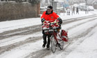 Postman and bike in snow