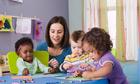 teacher and children in a creche