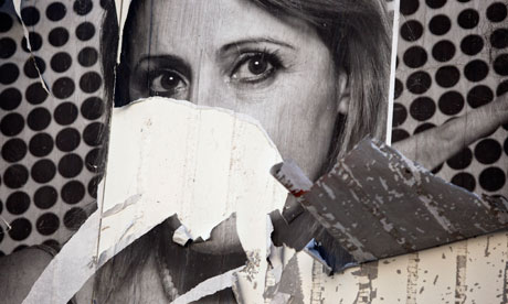 Ripped poster of woman in Jerusalem