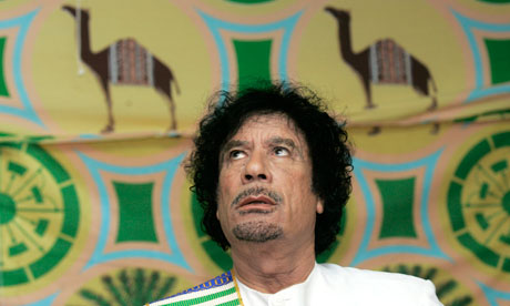 Libyan leader Muammar Gaddafi attends a news conference in a tent in Kiev