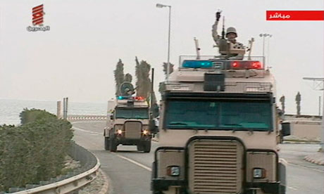 Saudi troops cross the causeway leading to to Bahrain after a plea for help from their neighbouring rulers. Photograph: REUTERS TV/Reuters