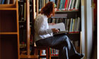 girl studies in a library in bath spa university