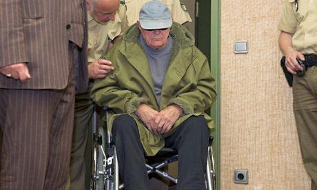 John Demjanjuk arrives in court in a wheelchair
