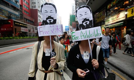 protesters in Ai Weiwei masks