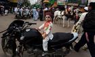 An Indian Muslim boy on a motorbike