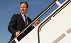 Prime minister David Cameron boards a plane