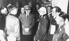 Hitler surrounded by officers following a failed assassination attempt, 20 July 1944.