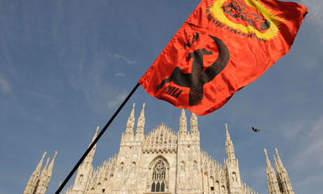 A communist flag being waved at Piazza del Duomo, Milan