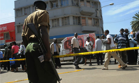 A Kenyan police officer at the scene of a bombing