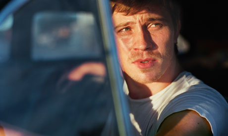 Garrett Hedlund as Dean Moriarty in On the Road.