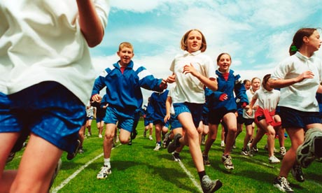 Children running a race at secondary school sports day Settle, North Yorkshire
