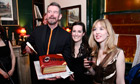Adam Mars-Jones receives his award from the Omnivore's Fleur Macdonald and Anna Baddeley