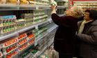 Women buy eggs in a supermarket