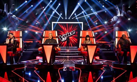 The judges in their swivel chairs in The Voice