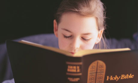 Girl reading the bible