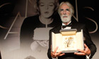 Michael Haneke with the Palme d'Or at the 65th Cannes film festival.