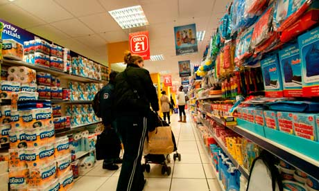 People wandering the aisles of a pound shop