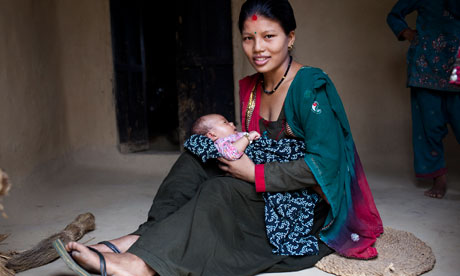Nisha Darlami, pictured with her one-month-old daughter in Nepal