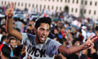 A Libyan man gestures as thousands of people march in Benghazi during a protest against militias