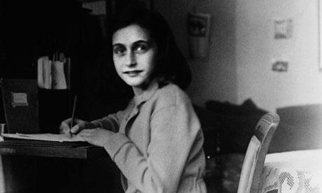 Anne Frank at her desk in Amsterdam.