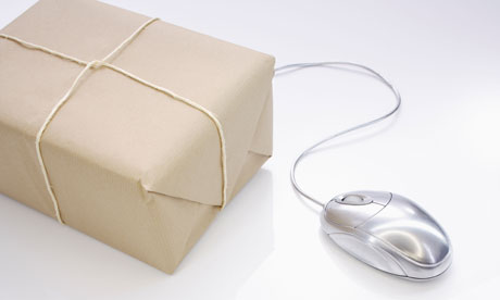 still life of parcel in brown paper and computer mouse for ecommerce and online shopping