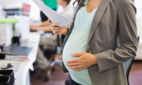 Pregnant businesswoman working in office. Image shot 2012. Exact date unknown.