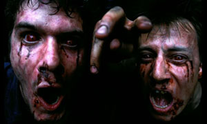 Two zombies from 28 Days Later rave at the camera