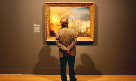 A visitor looks at Turner's The Burning of the Houses of Lords and Commons