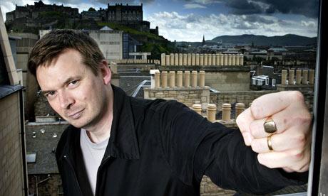 Ian Rankin on a balcony over looking Edinburgh Castle