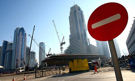 Construction halts in Dubai; image courtesy of The Guardian